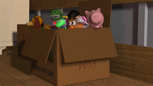 Packing Andy's toys in the moving box